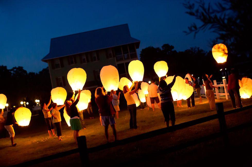 FIN Facilitators releasing lanterns