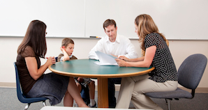 Student working with parents and teacher